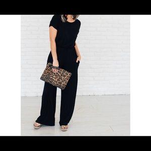 Black jumpsuit with hidden pockets.